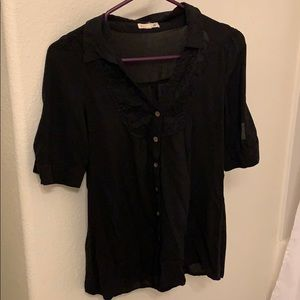 A black laced blouse.